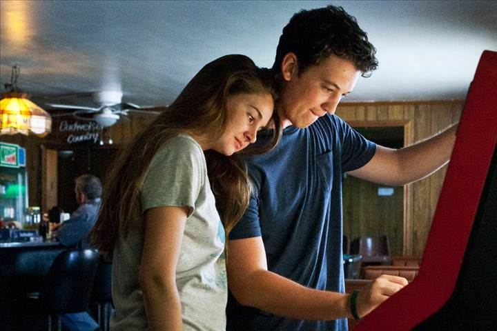 Miles Teller and Shailene Woodley browse through a jukebox
